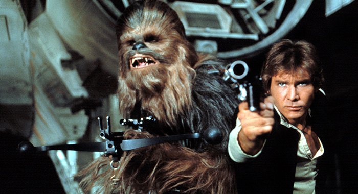 STAR WARS, (aka STAR WARS: EPISODE IV - A NEW HOPE), Chewbacca, Harrison Ford, 1977 (20th Century Fox/Everett Collection)
