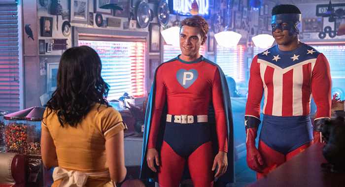 "Riverdale -- ""Chapter Sixty-One: Halloween"" -- Image Number: RVD404b_0249.jpg -- Pictured (L-R): Camila Mendes as Veronica, KJ Apa as Archie and Eli Goree as Munroe -- Photo: Jack Rowand/The CW -- © 2019 The CW Network, LLC. All Rights Reserved."