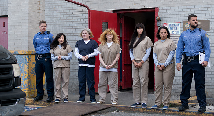 ORANGE IS THE NEW BLACK SEASON Season 7 PHOTO CREDIT JoJo Whilden PICTURED Nick Dillenburg, Yael Stone, Kate Mulgrew, Natasha Lyonne, Jackie Cruz, Selenis Leyva, Josh Segarra