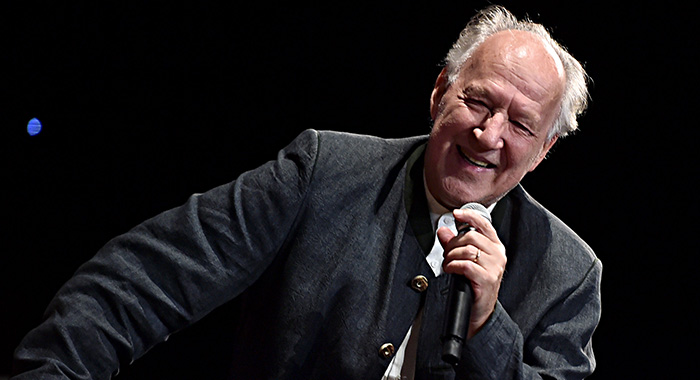 "HOLLYWOOD, CALIFORNIA - NOVEMBER 13: Werner Herzog speaks onstage at the premiere of Lucasfilm's first-ever, live-action series, ""The Mandalorian,"" at the El Capitan Theatre in Hollywood, Calif. on November 13, 2019. ""The Mandalorian"" streams exclusively on Disney+. (Photo by Alberto E. Rodriguez/Getty Images for Disney)"