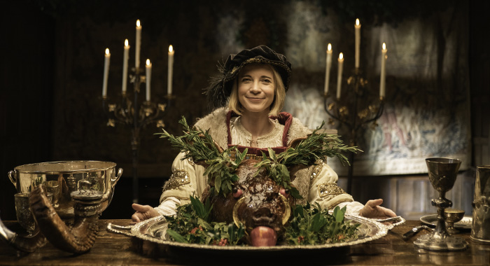 LUCY WORSLEY'S 12 DAYS OF TUDOR CHRISTMAS -Lucy Worsley in Henry VIII costume with boar's head. (Courtesy of Burning Bright Productions)