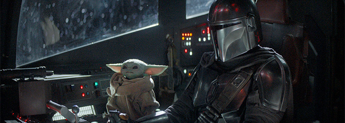 The Child (aka Baby Yoda) and Pedro Pascal as The Mandalorian (Disney+)