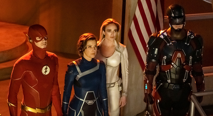 "Supergirl -- ""Crisis on Infinite Earths: Part One"" -- Image Number: SPG509b_0410r.jpg -- Pictured (L-R): Grant Gustin as The Flash, Audrey Marie Anderson as Harbinger, Caity Lotz as Sara Lance/White Canary and Brandon Routh as Ray Palmer/Atom -- Photo: Katie Yu/The CW -- © 2019 The CW Network, LLC. All Rights Reserved."
