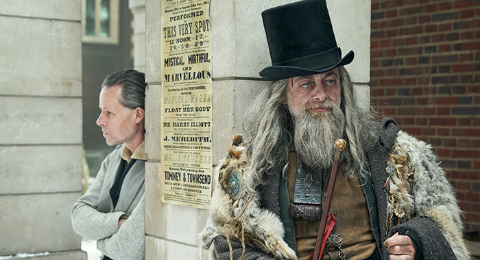 A CHRISTMAS CAROL -- Pictured: Guy Pearce as Ebenezer Scrooge, Andy Serkis as Ghost of Christmas Past. CR: Robert Viglasky/FX