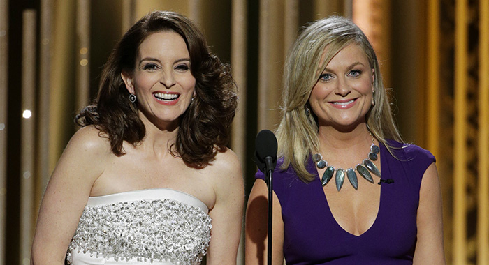 BEVERLY HILLS, CA - JANUARY 11: In this handout photo provided by NBCUniversal, Hosts Tina Fey and Amy Poehler speak onstage during the 72nd Annual Golden Globe Awards at The Beverly Hilton Hotel on January 11, 2015 in Beverly Hills, California. (Photo by Paul Drinkwater/NBCUniversal via Getty Images)
