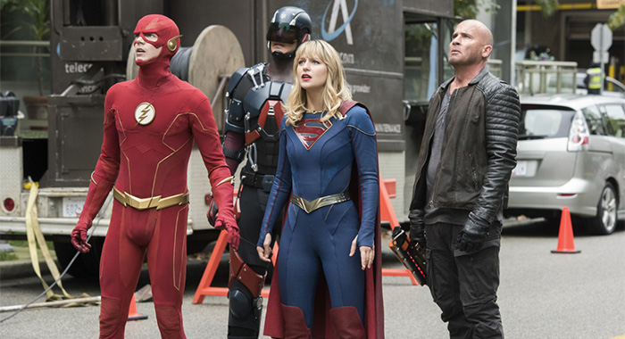 "Legends of Tomorrow -- ""Crisis on Infinite Earths: Part Five"" -- Image Number: LGN508b_0265b.jpg -- Pictured (L-R): Grant Gustin as Barry Allen, Brandon Routh as Ray Palmer/Atom, Melissa Benoist as Kara/Supergirl and Dominic Purcell as Mick Rory/Heatwave -- Photo: Colin Bentley/The CW -- © 2020 The CW Network, LLC. All Rights Reserved."