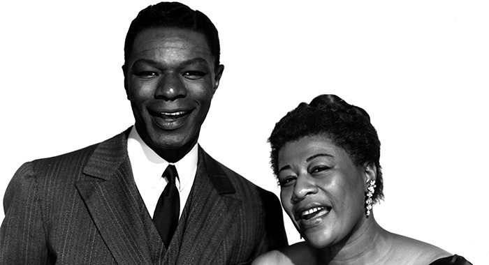 NAT 'KING' COLE, and ELLA FITZGERALD, singing together during THE NAT KING COLE SHOW, 1956 (Courtesy Everett Collection)