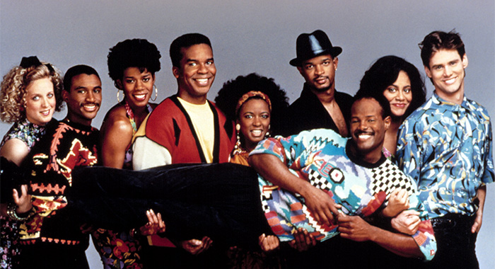 IN LIVING COLOR, Kelly Coffield, Tommy Davidson, Kim Wayans, David Alan Grier, Damon Wayans, Kim Coles, Jim Carrey, Keenen Ivory Wayans (being held by cast), 1990-94, TM and Copyright (c)20th Century Fox Film Corp. All rights reserved.