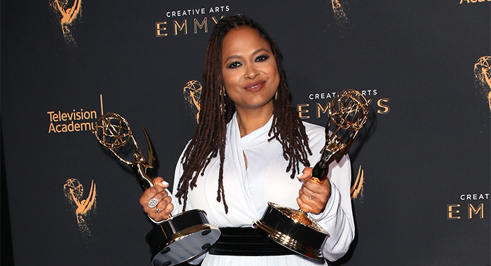 "LOS ANGELES, CA - SEPTEMBER 09: Ava Duvernay poses in the press room with the awards for outstanding documentary or nonfiction special and outstanding writing for nonfiction programming for ""13th"" during the 2017 Creative Arts Emmy Awards at Microsoft Theater on September 9, 2017 in Los Angeles, California. (Photo by David Livingston/Getty Images)"