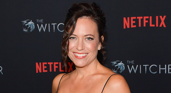 "Lauren Schmidt Hissrich attends the photocall for Netflix's ""The Witcher"" season 1 at the Egyptian Theatre on December 03, 2019 in Hollywood, California. (Photo by Matt Winkelmeyer/Getty Images)"