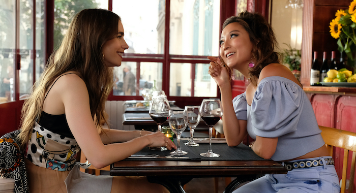 LILY COLLINS and ASHLEY PARK in Emily in Paris season 1