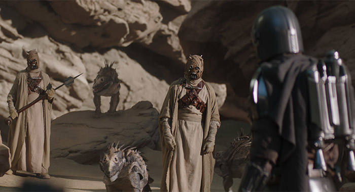 Sand people and Pedro Pascal in The Mandalorian season 2, episode 1