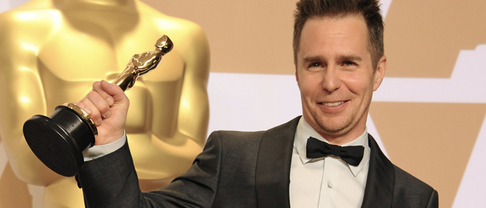 Sam Rockwell holding his Oscar in 2018