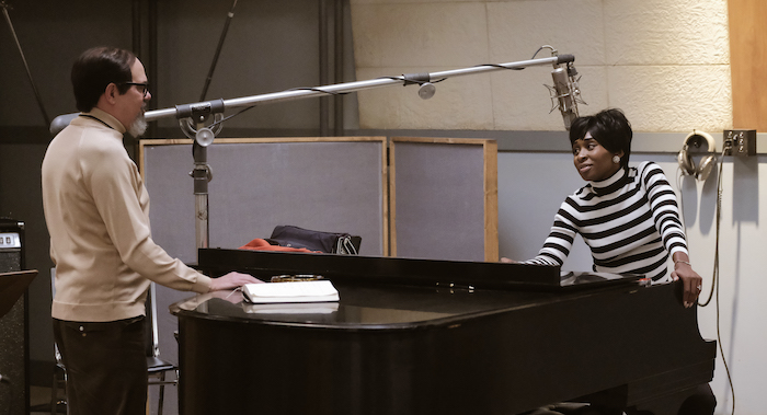 Music producer Jerry Wexler (L), played by David Cross, talks with Aretha Franklin, played by Cynthia Erivo, in the studio. (Credit: National Geographic/Richard DuCree)