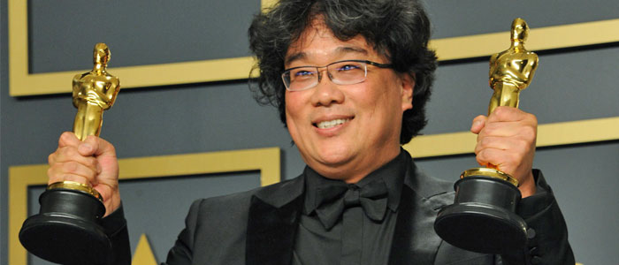 Bong Joon-Ho holding his two Oscars in 2020