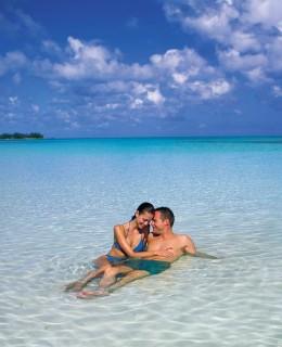 Couple-enjoying-the-beach