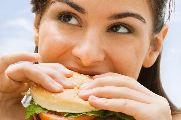 Teenage+girl+eating+a+hamburger