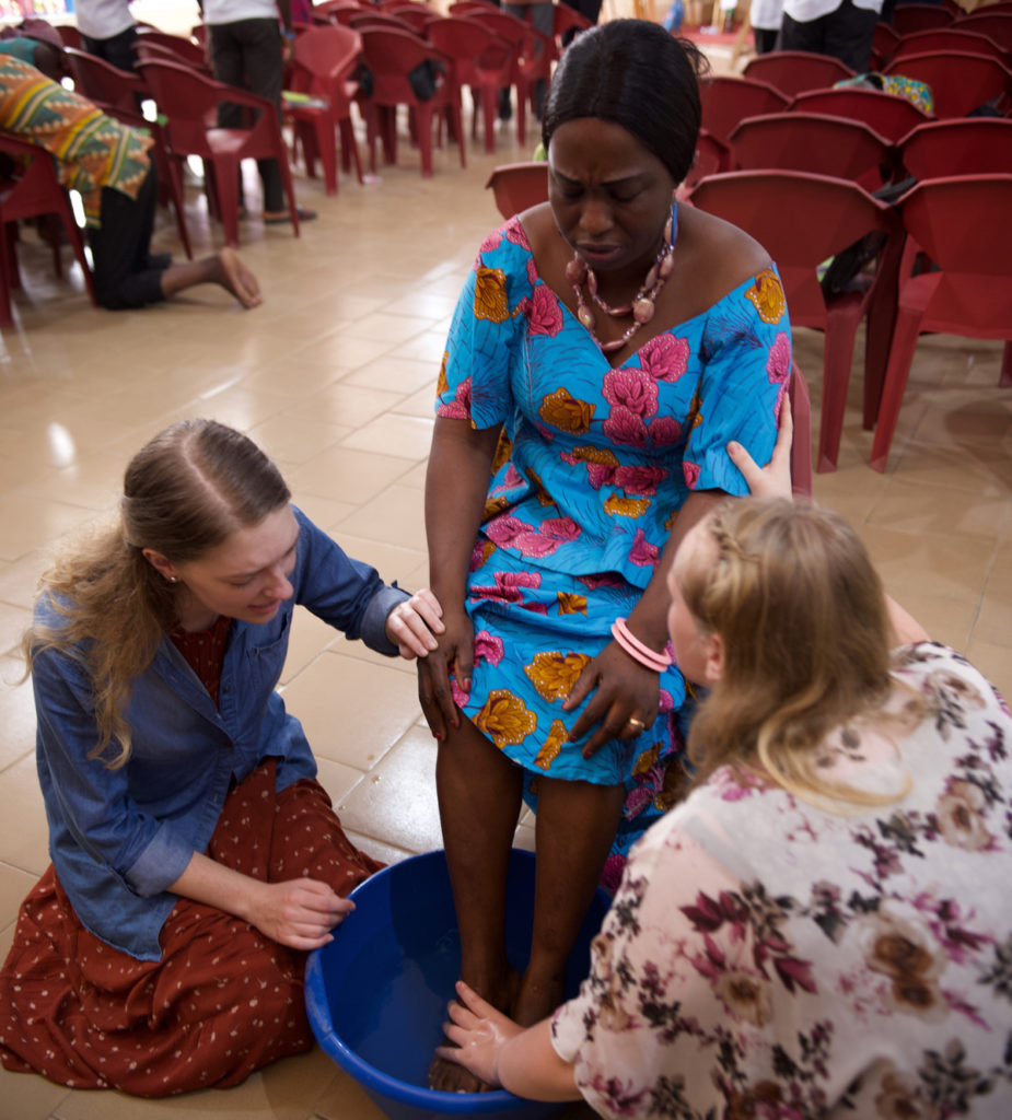 Two of our team members washing the feet of a disciple in preparation for the mission.