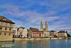 Zürich – ősi paloták és a Grossmünster ikertornyai a Limmat folyó mentén