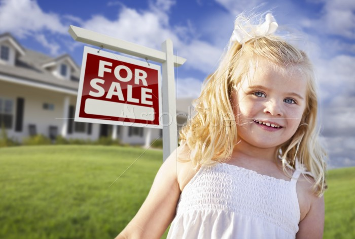Smiling Girl in Yard with For Sale Sign