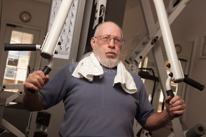 Elderly Adult Man Working Out in the Gym