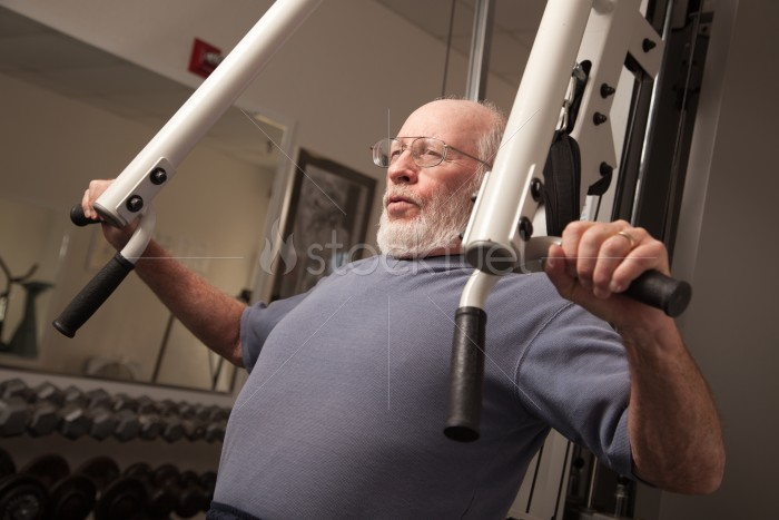 Senior Adult Man Working Out in the Gym