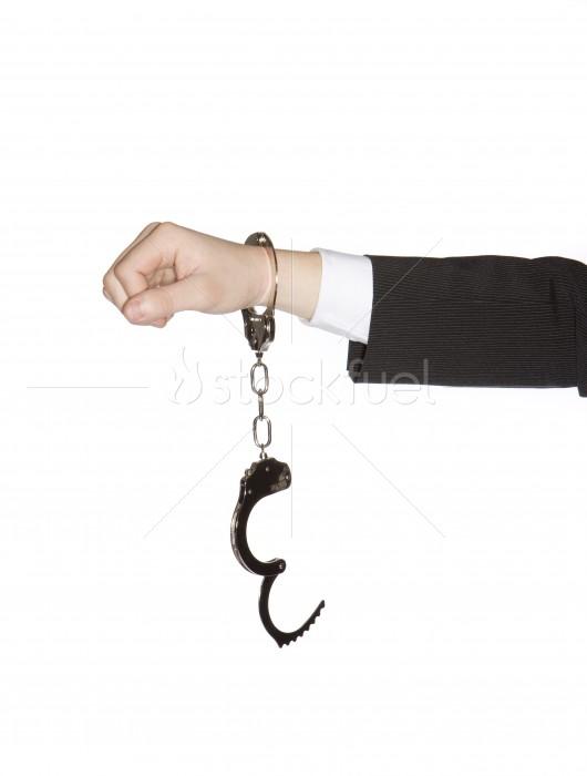 Businessman in Hand Cuffs