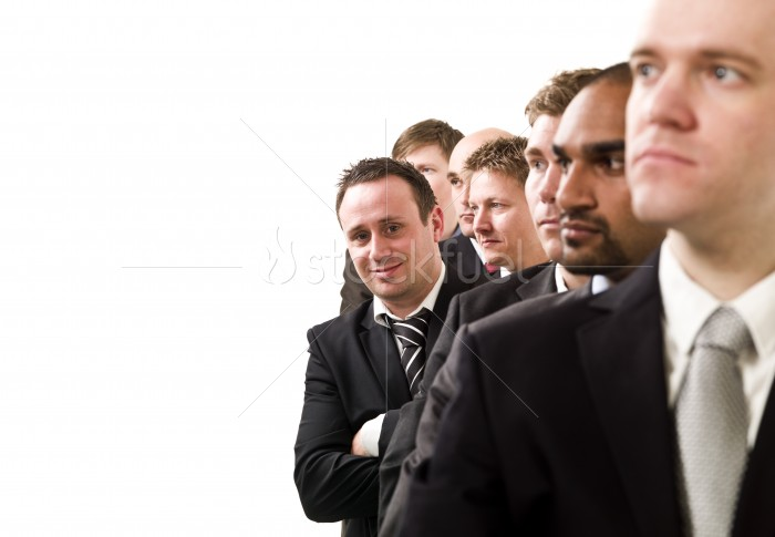 Businessmen Lined Up in a Queue
