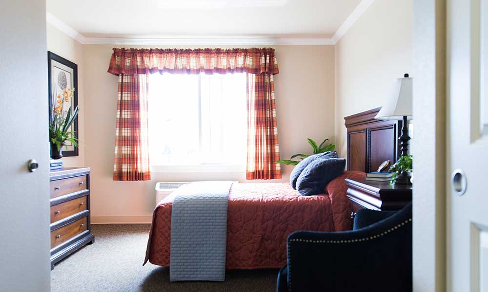 Natural light graces a bedroom at Juniper Glen Alzheimer's Special Care Center