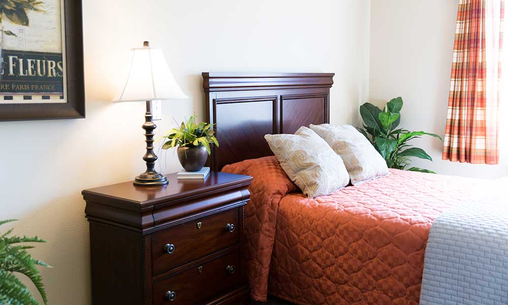 A comfy bedroom at Juniper Glen Alzheimer's Special Care Center