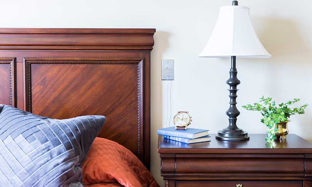 A nightstand adds the finishing touch to Juniper Glen Alzheimer's Special Care Center bedrooms.