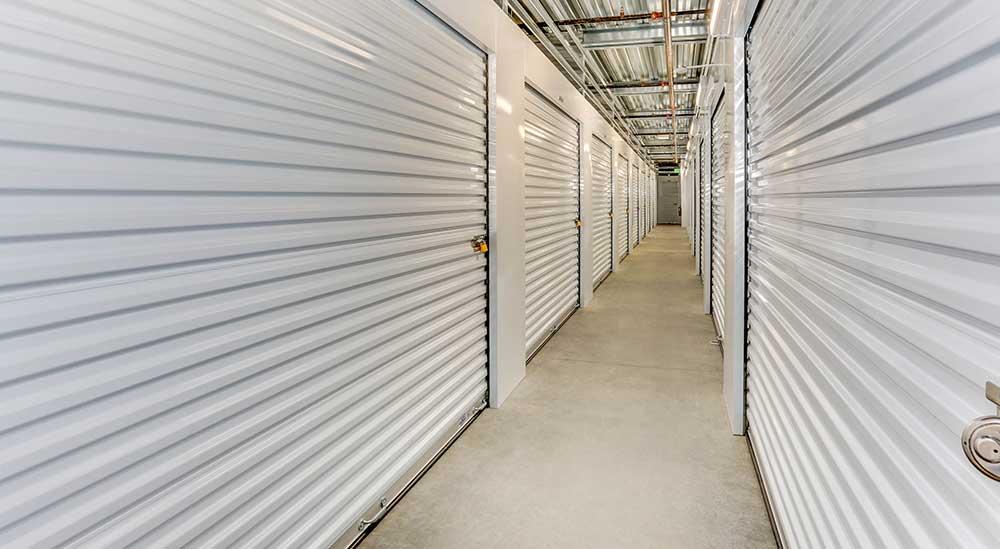 Indoor roll-up door at Happy Boxes Self Storage