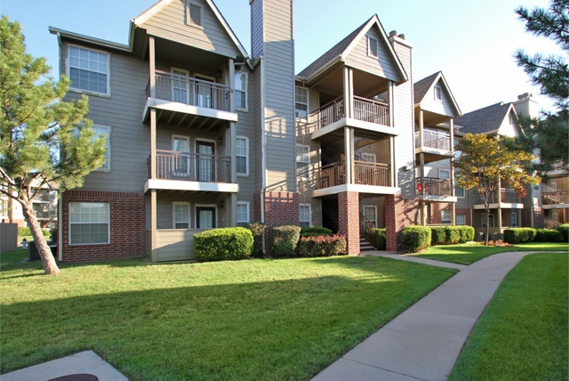 Beautifully landscaped grounds at Crown Chase Apartments in Wichita, KS