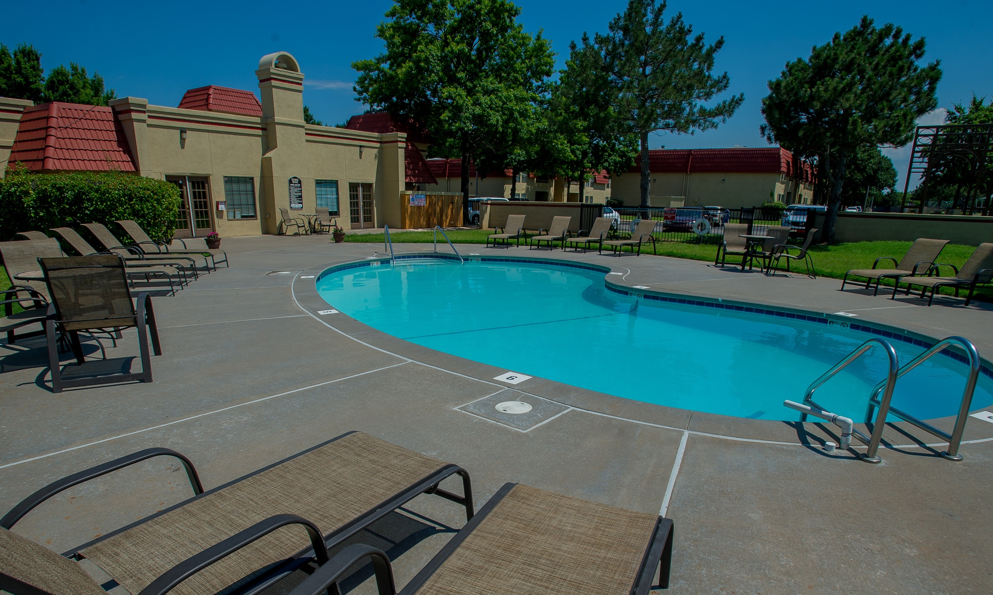 Swimming pool view at apartments in Oklahoma City, OK