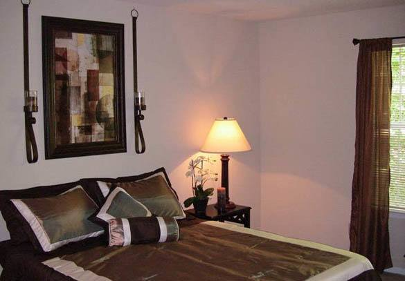 Comfortable bedroom at Lake Sweetwater Apartments in Lawrenceville