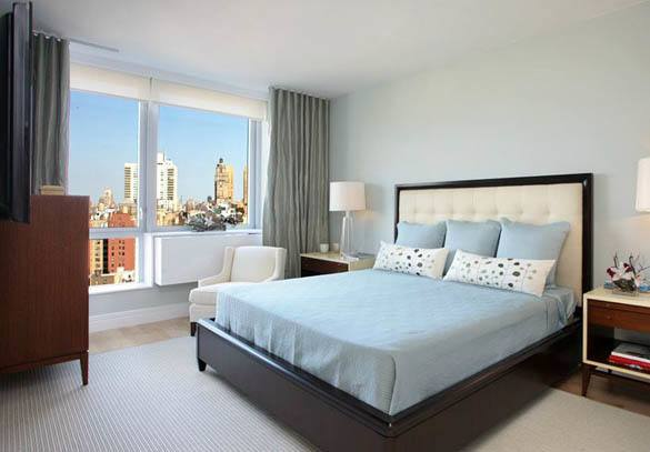Bedroom with view of New York at The Corner, Upper West Side