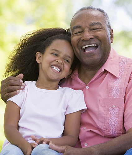 Grandfather with granddaughter at Chateau Retirement Communities