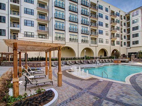 Enjoy the pool at our luxury apartments in {{location_city}}