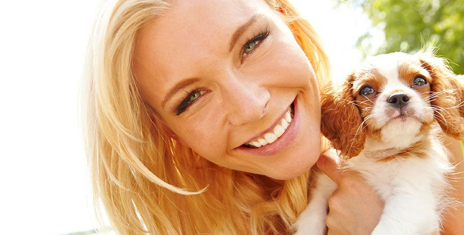 Woman smiling at her pup
