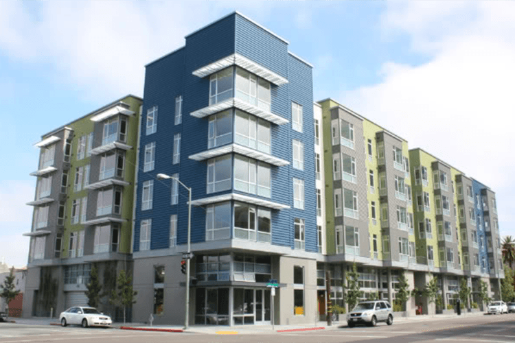 A rendering of the street corner of apartments in Oakland