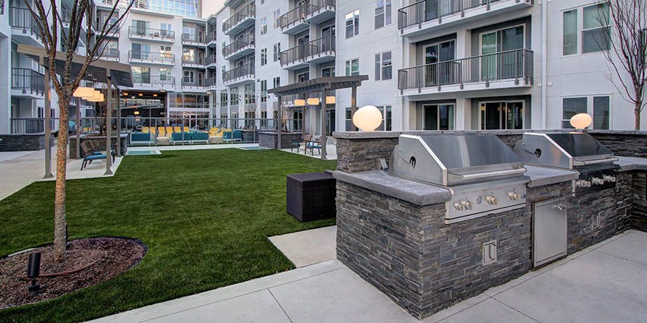 Outdoor grilling area at luxury apartments