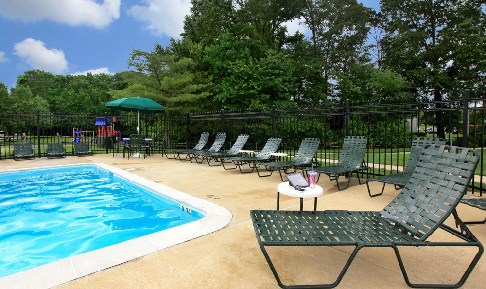 Lounge by our sparking community pool at The Seasons in Laurel, Maryland
