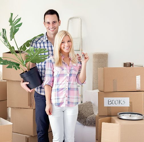 Couple moving and excited to have gotten supplies at Urban Self Storage