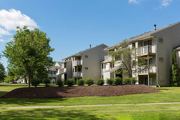 Penbrooke Meadows Apartments in Penfield community with landscaped grounds