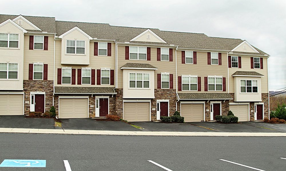 Front of building and garages to our Harrisburg, PA apartments