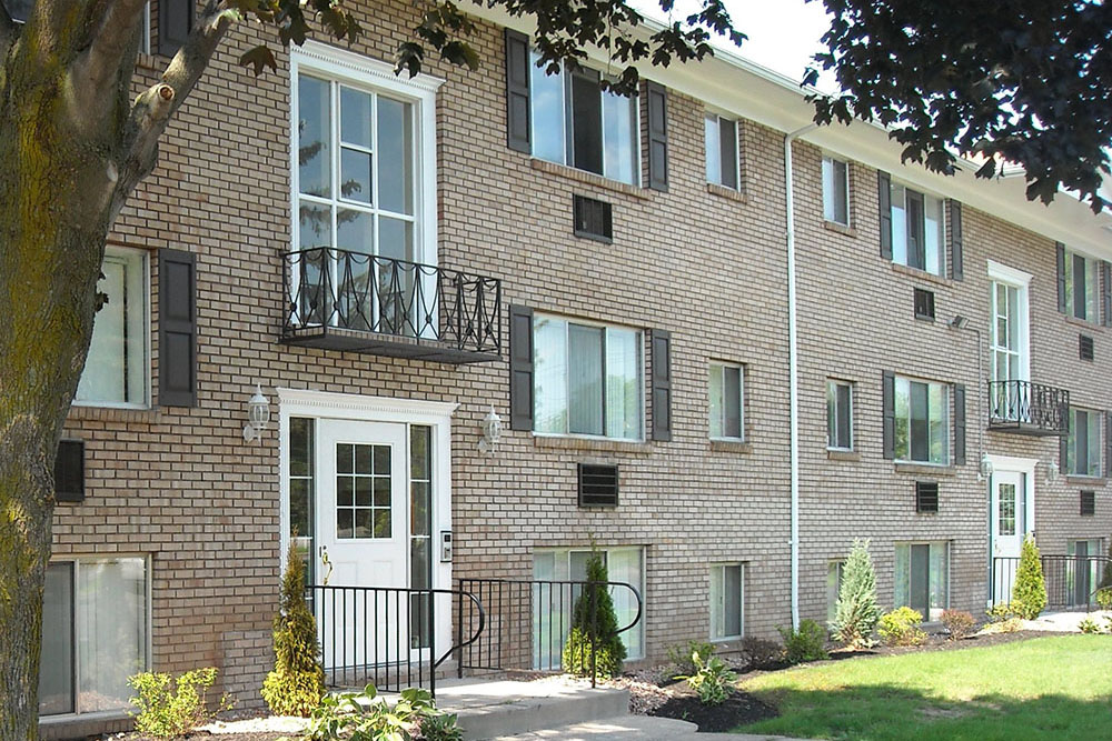 Building Exterior at Pittsford Garden Apartments in Pittsford, NY
