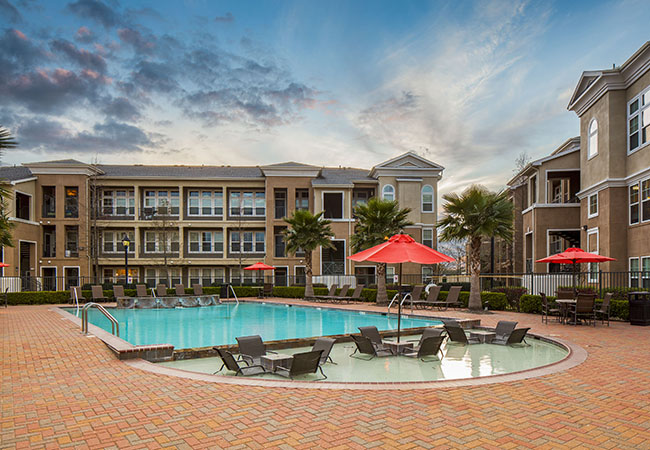 Resort-style swimming pool at Millennium Towne Center apartments for rent in Baton Rouge, LA