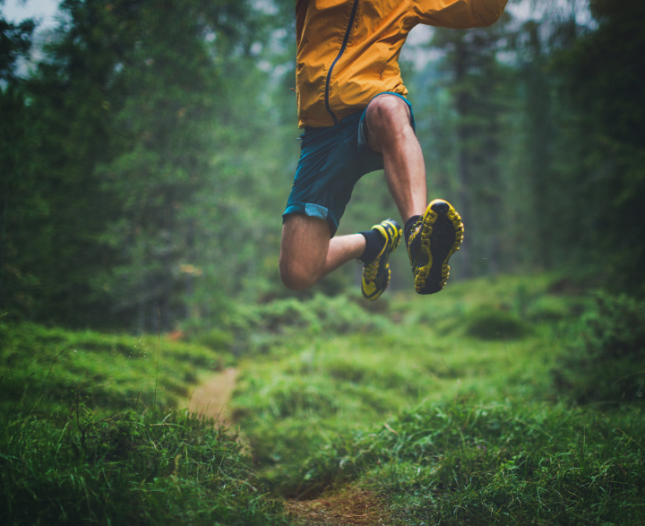 Person jumping while trail running
