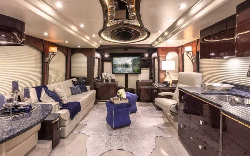 Interior of RV with kicthen, couches and TV