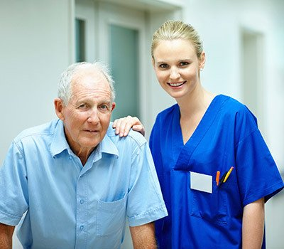 Nurse exemplifying what it means to provide excellent senior living care at Randall Residence.